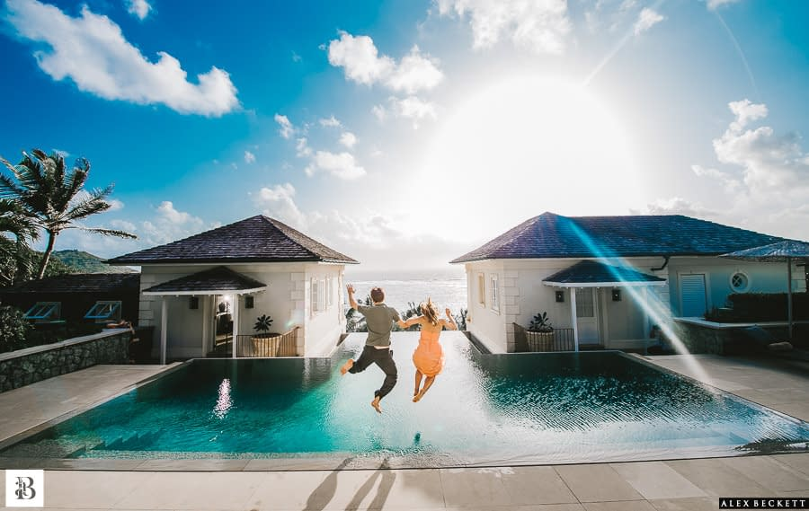 AlexBeckett-13 Bridge and groom couple jump into pool caribbean mustique wedding Sunrise house